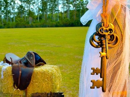 Eternal Weddings Décor and Photography. Country Wedding Decorations. Hay bale. Horse Saddle. Horse Shoe. Rustic Keys. Wedding Arbour