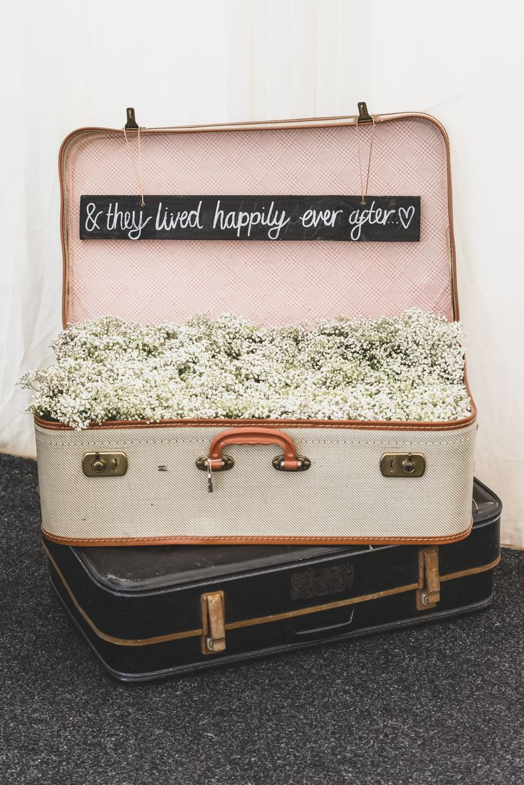 Boho wedding ideas! Suitcase filled with gypsophilia - & they lived happily ever after!