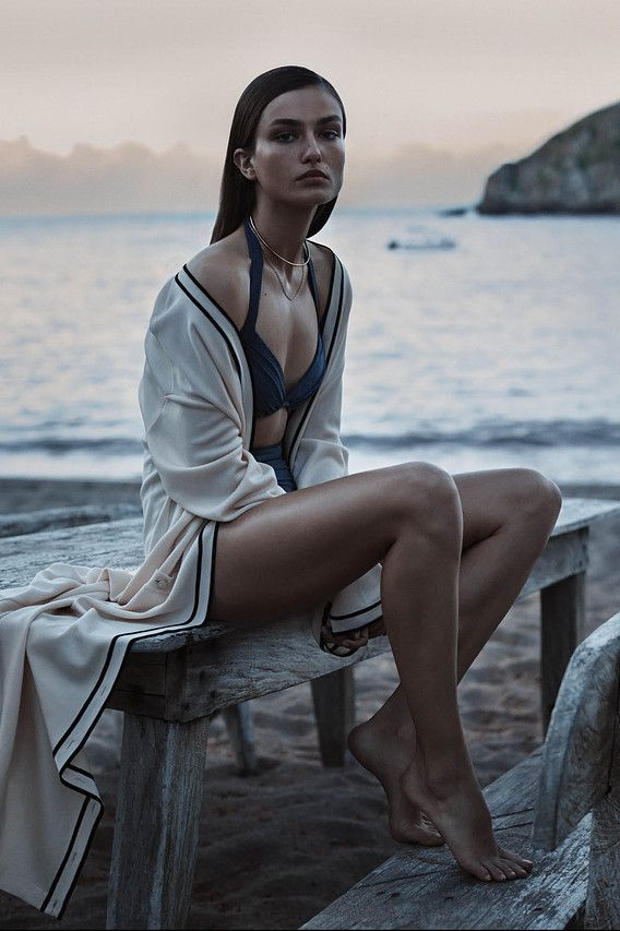 <strong>AFTER HOURS</strong> | A light wrap transitions beachwear from day to dusk. Chanel robe, $4,300, 800-550-0005, Michael Kors swimsuit, $380, michaelkors.com, and Jennifer Fisher choker, $200, and chain, $460, both jenniferfisherjewelry.com