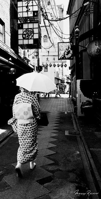 """Geisha / 12:05"", walking down the street"