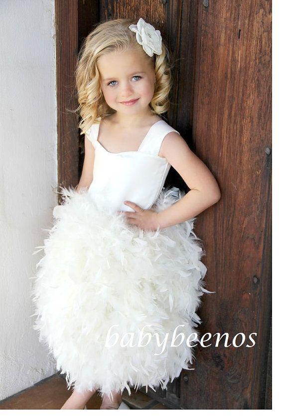 This little girl is so cute... not so sure of the dress though! Flower Girl Dress   Feather Dress Corset back  Lily  by babybeenos, $178.00