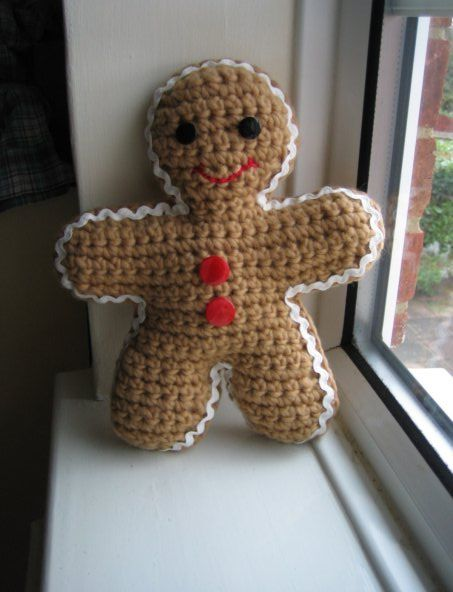 Crochet Gingerbread man with a ric rac border.  No pattern but here's a very similar gingerbread man: http://www.pinterest.com/pin/150870656240614669/