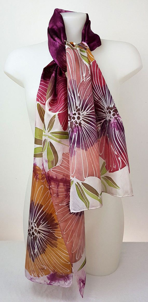 Hand-painted truly unique one of a kind silk scarf that cannot be re-created again. Long hand- painted and shibori silk scarf featuring large garden flowers in stunning combination of pink , yellow and fuchsia colour shades with green leaves. Its made of luxury habotai silk fabric.  First, I hand-dye the background and then paint the ends to achieve dramatic and intricate look. I chose my favourite large garden flowers and used bold and vibrant tones. The shibori background is dyed in…