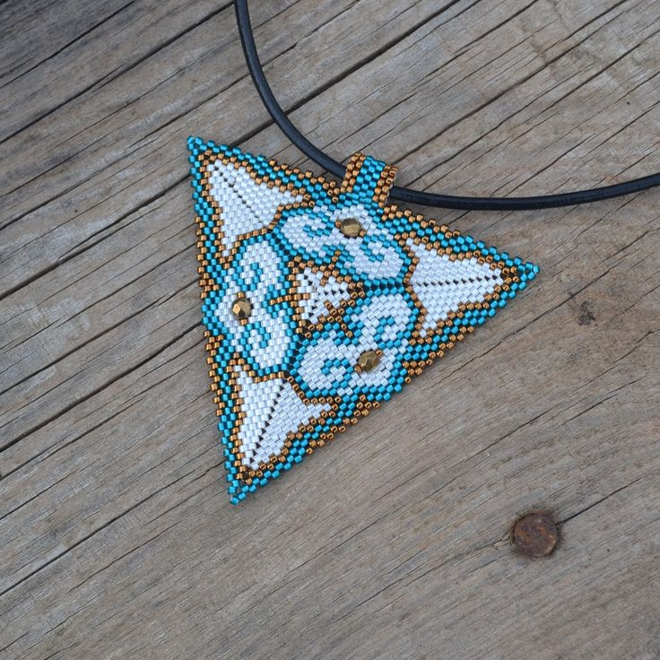 Floral pendant, beaded necklace, triangle pendant, seed bead necklace, big beading necklace, geometric necklace, beaded triangle Pendant by SzkatulkaAmiJewelry on Etsy https://www.etsy.com/listing/530637960/floral-pendant-beaded-necklace-triangle