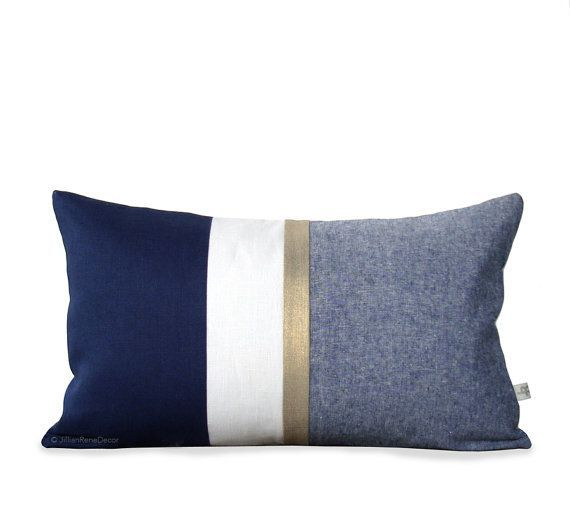NEW :: A metallic gold stripe and yarn dyed chambray gives layers of texture to this chic navy and cream pillow cover set. This color…