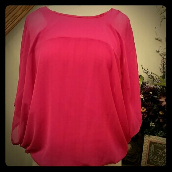 Batwing top Fuschia pink batwing sleeve top.  Can be worn two ways- with v in front or back.  Attached tank underneath.  Never worn, tags attached.  Runs a bit big for a small.  Could fit a medium as well.   Outer layer- 100% poly,  inner layer - cotton , modal ***Proceeds from this sale will be donated to my cousin to help her battle breast cancer*** Express Tops Blouses