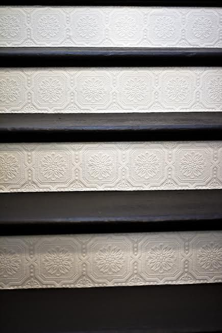 Add paintable and textured wallpaper on the stair risers - great DIY project, and affordable - under $30!