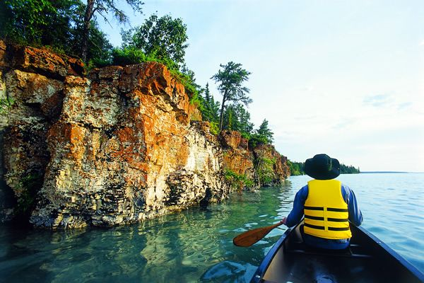 Paddle through the rock caves at Caddy Lake. Read more about the Whiteshell in Manitoba. #exploremb