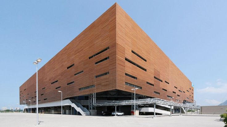 Brazilian architects Lopes, Santos & Ferreira Gomes and London-based firm AndArchitects have created a handball arena for the Rio Olympics that will be dismantled at the end of the Games and rebuilt as four schools throughout the city.