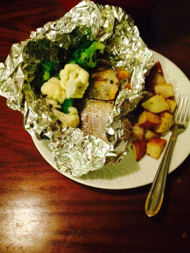 My family LOVES fish! So for dinner I cooked up some roasted PORGY fish ( yes it can be roasted in the oven)  Oven roasted red skin potatoes, broccoli and cauliflower.   Secret ingredients can be provided at your request.  THIS Roasted fish was soo yummers!