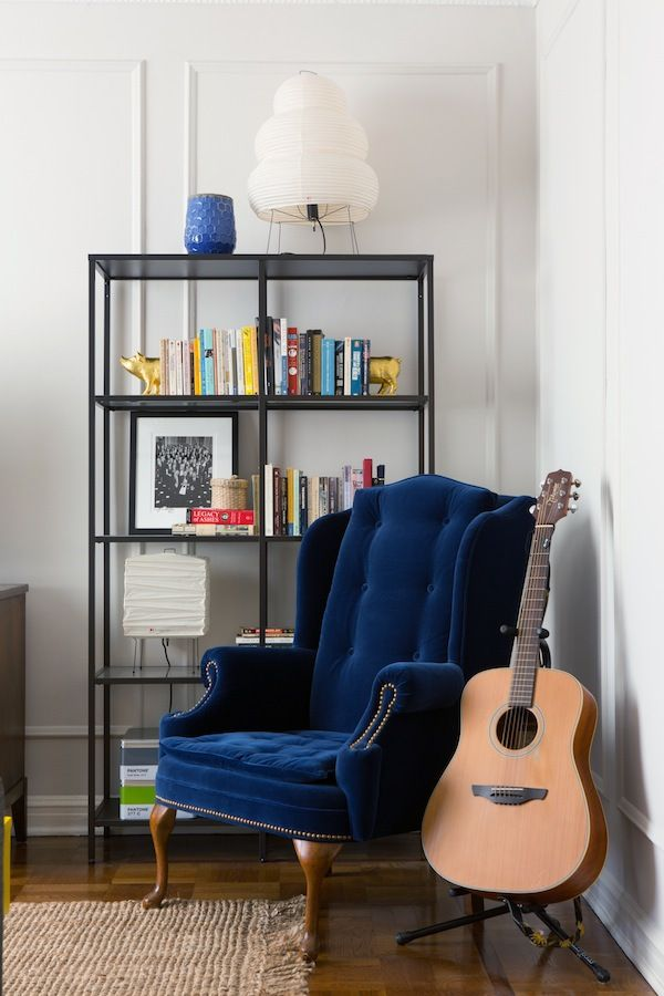 Inspiration- love this little nook- the metal shelves (ikea vittsjo) and that blue velvet chair!