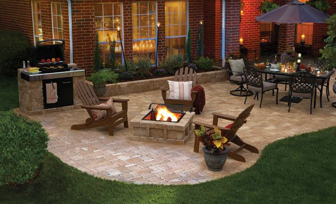 Nice backyard patio on pavers with bbq  pit and table for dining  Love the raised candle huricanes for ambience