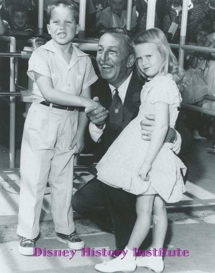 Walt Disney with the first two children to enter Disneyland on opening day, July 17, 1955.