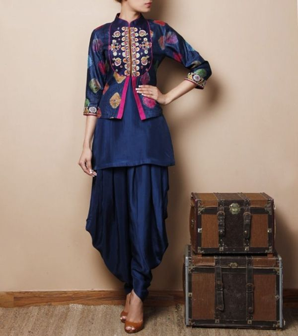 Blue Silk Kurti with Jodhpuris and a jacket that has a tie-dye design, mirror embroidered yoke and pink piping... by tracie
