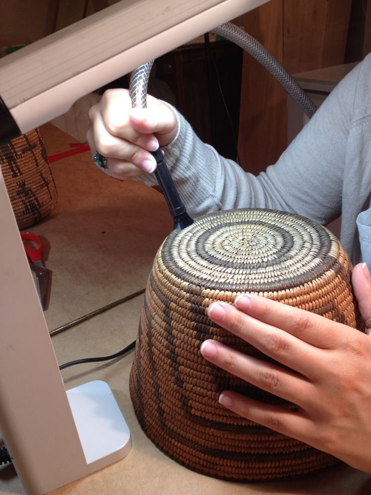 The cleaning of a historic basket performed by Spicer Art Conservation, conservators of objects, textiles, paper and upholstered furnishings.