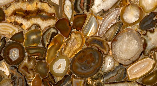 """Brown Agate Surface by Caesarstone     2014 Design Trend      """"Companies such as Caesarstone and Antolini have devised composite surfaces that mimic malachite, agate, and other exotic semi-precious stones, perfect for dramatic countertops and backsplashes.  Kitchens are becoming downright glamorous."""" Find this and much more @Nature Of Marble"""