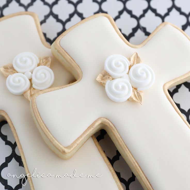 Decorated sugar cookies for a communion. Gold, ivory and a bit of white combine to make classic looking cross cookies.