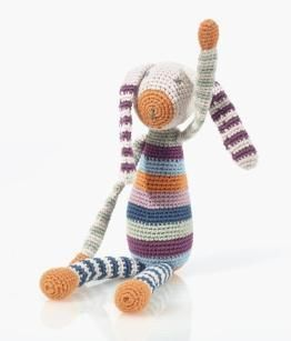 Made from organic cotton and in subtle colours, this bunny is a wonderful unisex gift. This crocheted toy was handmade by women in Bangladesh, so slight variati