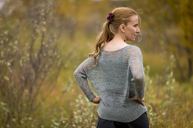 A simple and soothing garter drop-stitch project, this easy, slouchy, dolman-sleeved top layers perfectly for warm autumn days and cool summer evenings. Solid and multi-coloured yarns work equally well.