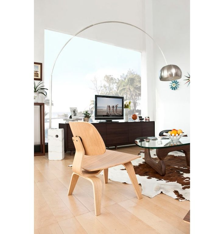 Lamp Arco by Achille Castiglioni for Flos, LCW Plywood chair by Charles and Ray Eames. Coffee Table by Isamu Noguchi for Vitra.