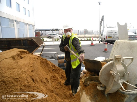 CSC Screed technician hard at work with the aggregates and screed pump.