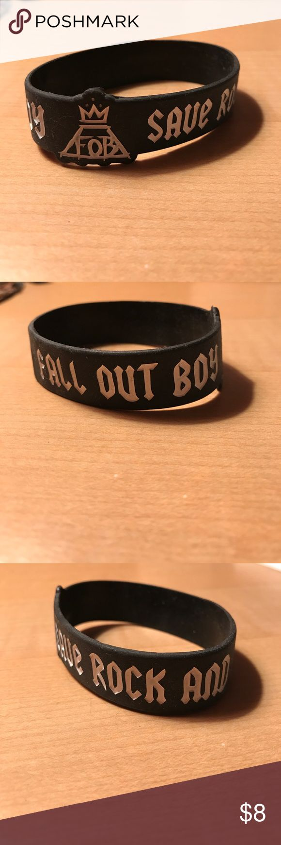 "Fall Out Boy Bracelet This was bought at a Fall Out Boy concert and is official merchandise. It has the band's symbol with ""Fall Out Boy"" on one side and ""Save Rock and Roll"" in the other. It is black with white letters. It measures 2.5"" in diameter but is stretchy enough to accommodate a larger wrist. Jewelry Bracelets"