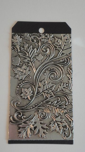 handmade tag ... Creative Chemistry 102 (Tim Holtz) 023 by clperry ... super cool look ... embossing folder texture on duct tape ... inked around edges for fabulous depth ... great tag!