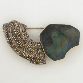 Harold O'Connor at Patina Gallery. Part of the 'Wabi Sabi' Exhibition, 2004. Pin, 18K Gold granulation on Sterling Silver, Spectrolite stone.