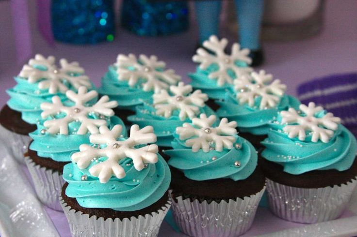 Snowflake topped cupcakes at a Frozen girl birthday party!   See more party planning ideas at CatchMyParty.com!