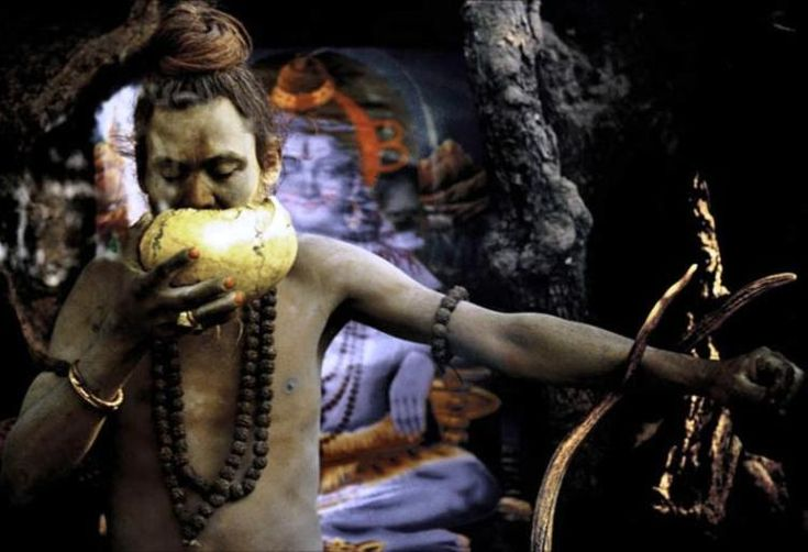 """The Aghori is considered to be a religious cult that broke away from the overarching Hindu religion in the 14th century AD. In Hindu mythology, it is believed that everything emanates from """"Brahman"""" and that no evil exists. Aghori followers take this interpretation further by believing that everything is god and to abandon anything is sacrilege. This belief manifests itself into crude rituals, particularly their practice of dwelling near cremation grounds and eating the corpse of the…"""