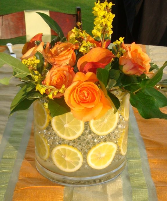 Or fill with ice, with citrus spaced between or could cut slices. As ice melts, the level would stay the same, but the centerpiece design would change.