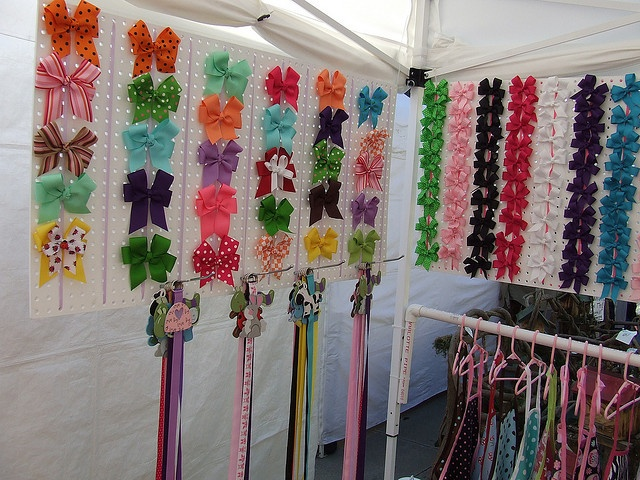 Bigger bows displayed. Like the pegs on the bottom for bow holders. Also like the PVC to hang tutus on