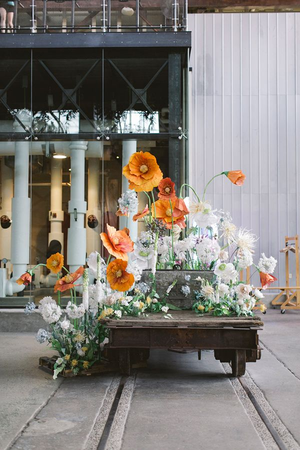 Giant paper flowers - love these. Philadelphia Industrial Wedding (featured on Ruffled blog)