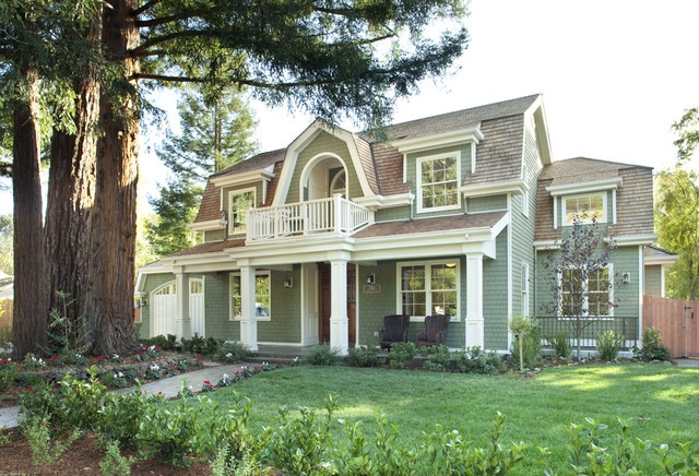 The symmetrical front facade gives this home the formal and balanced appearance all colonial revivals are known for, while the gambrel detailing sets it apart as a Dutch colonial.