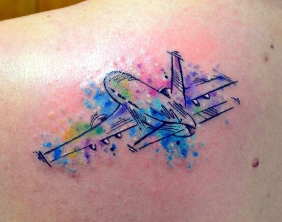 Watercolor Airplane Tattoo by Javi Wolf. I love the look, I would use a different aircraft though .