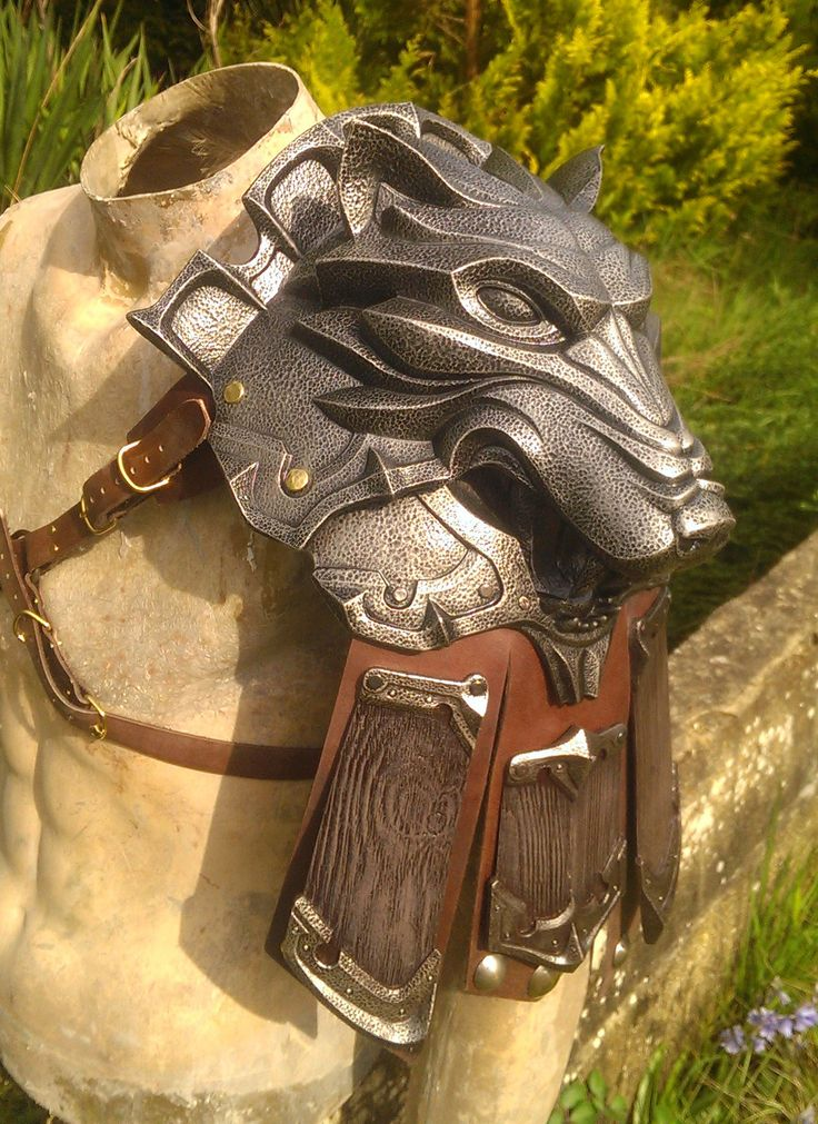 WolfShoulder by DragonArmoury wolf shoulder guard leather armor cosplay costume LARP LRP fashion clothes clothing equipment gear magic item   Create your own roleplaying game material w/ RPG Bard: www.rpgbard.com   Writing inspiration for Dungeons and Dragons DND D&D Pathfinder PFRPG Warhammer 40k Star Wars Shadowrun Call of Cthulhu Lord of the Rings LoTR + d20 fantasy science fiction scifi horror design   Not Trusty Sword art: click artwork for source