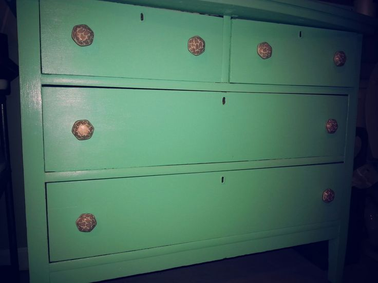 Salvaged deesser painted tiffany blue with ecclectic rose gold & ivory pulls. Currently at home in our bathroom.