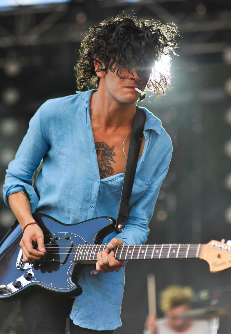 the 1975... reminds me of Slash with the smoke and eyes covered.