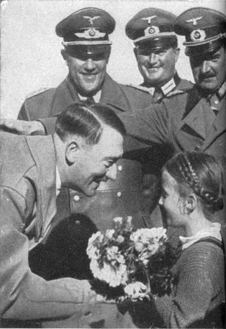 Adolf Hitler receiving flowers from a girl in 1937. | all ...