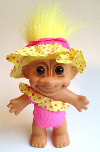 """My Lucky Swimsuit 6"""" Troll Doll. TWIST: This super cute troll also has a swimming ring. It matches the yellow in the pin with its yellow swimming outfit and in its yellow hair. It is ready to join the puppy in the pool."""