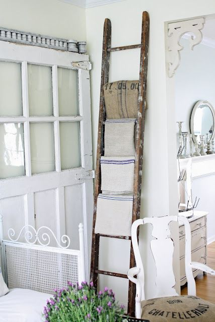 25 Unique Ways to Decorate with Vintage Ladders - hang towels, kitchen pots, lanterns, shoes, or use as wall art to display framed photos & signs / art