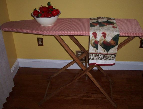 Vintage Wooden Ironing Board with new fabric cover. Nice primitive wooden ironing board - perfect for a country rustic decor. Measures 48 long x 32 high x 12 wide. Only $49 at Annette's Attic.