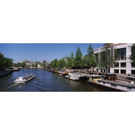 Opera house at the waterfront Amstel River Stopera Amsterdam Netherlands Canvas Art - Panoramic Images (18 x 7)