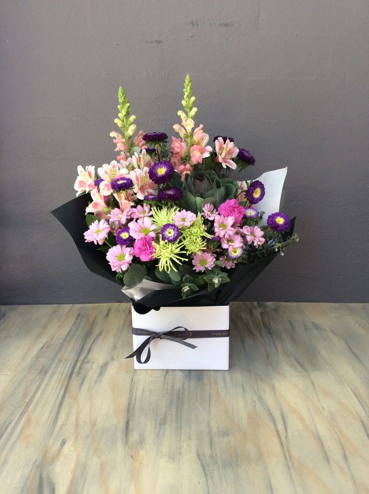 Pastels and some beautifully rich Asters compliment this arrangement, from our Simply Stunning Range