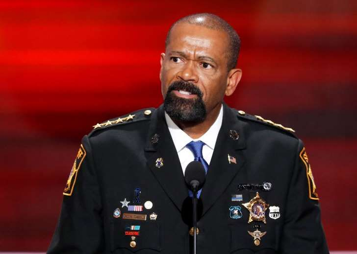 FILE - In this July 18, 2016 file photo, Milwaukee County Sheriff David Clarke speaks during the opening day of the Republican National Convention in Cleveland. Milwaukee resident Dan Black says Clarke had deputies question him after a flight because he shook his head at the lawman, who has gained national prominence for supporting Donald Trump. Black says in a complaint submitted to the sheriff's website, he shook his head because Clarke was wearing Dallas Cowboys clothes on Sunday, Jan…