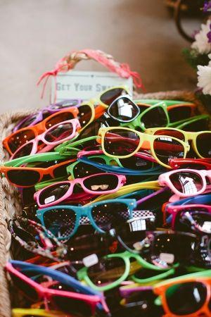 Rainbow assorted plastic sunglasses for the reception