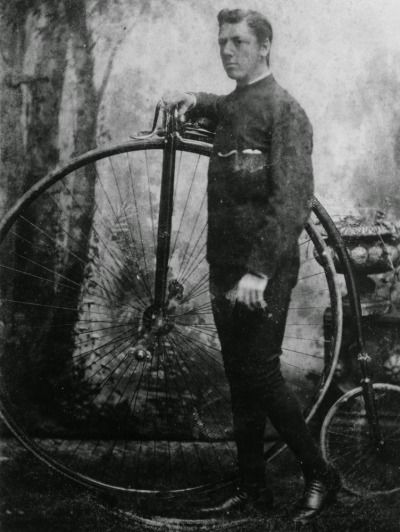 A young man in a studio with a penny-farthing, Queensland, Australia, 19th C