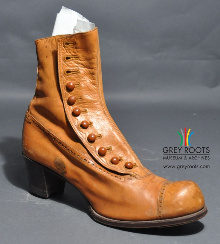"""A yellowy-orange coloured, button-up, """"Blachford"""", ladies' shoe. It has eleven buttons and a rounded toe. Grey Roots Museum & Archives Collection."""