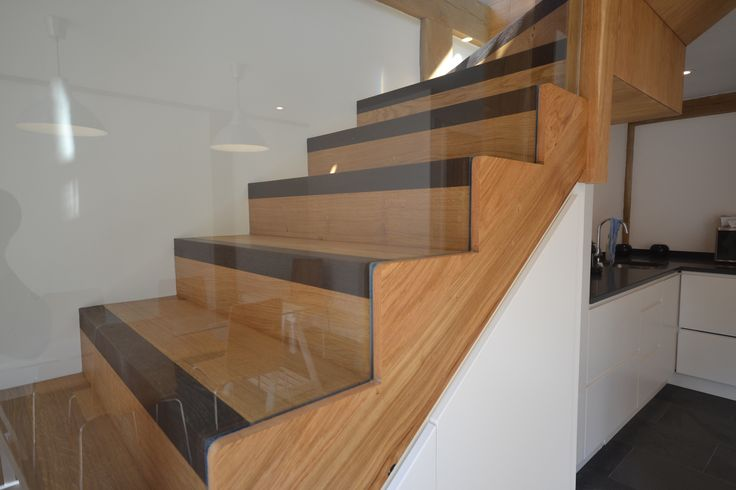 Custom-built oak staircase with charming wenge hardwood accents on each step.