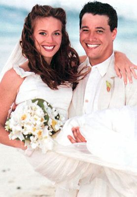 Amber Brkich and Rob Mariano at Their Wedding in the Bahamas-2005 which was a 2hr special on tv. They met on Survivor All-Stars in 2003. They have 3 daughters and expecting their 4th child in 2014.